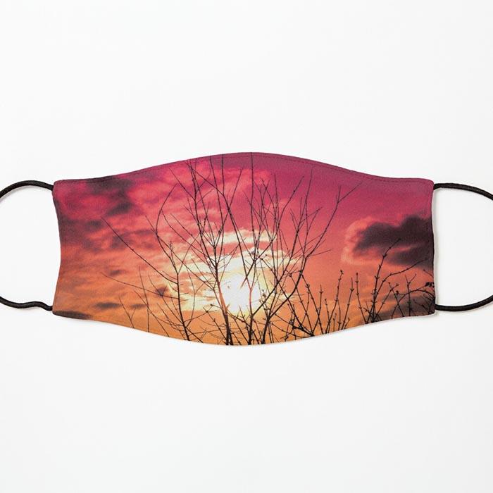 masque silhouette arbre et coucher du soleil